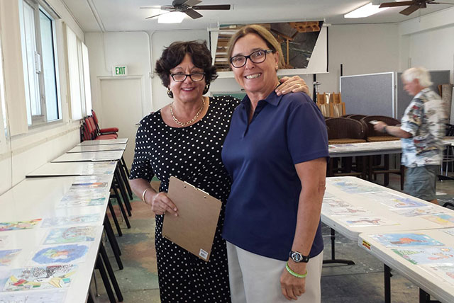 Passidomo with Charlette Roman at ornament judging