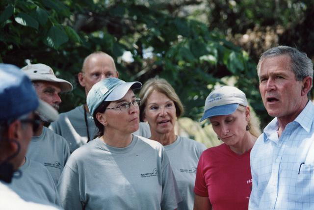 President Bush speaking with Charlette Roman
